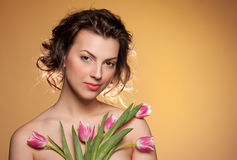 Portrait of a beautiful girl with a tulips Royalty Free Stock Image