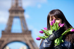Portrait of a beautiful girl with tulips in Paris Royalty Free Stock Photo