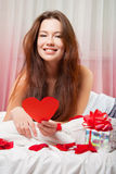 Portrait of a beautiful girl with a valentine Stock Images