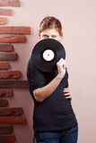 Portrait of beautiful girl with vinyl disc Royalty Free Stock Photo