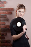 Portrait of beautiful girl with vinyl disc Stock Photo