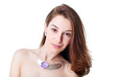 Portrait of beautiful girl with violet flower bijouterie Royalty Free Stock Photography
