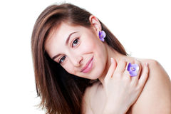 Portrait of beautiful girl with violet flower bijouterie Royalty Free Stock Photo