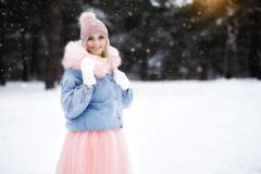 Portrait of a beautiful girl on a walk in the winter forest stock photography