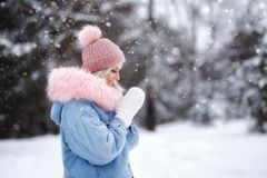 Portrait of a beautiful girl on a walk in the winter forest. good New Year spirit stock photos