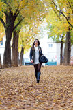 Portrait of beautiful girl walking in autumn. Royalty Free Stock Photography