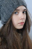 Portrait of a beautiful girl in a warm knitted hat. Stock Image
