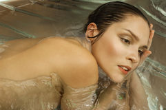 Portrait of the beautiful girl in water Stock Photos