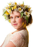 Portrait of a beautiful girl wearing flowers hat. Royalty Free Stock Images