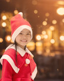 Portrait of beautiful girl wearing Santa Claus hat . Royalty Free Stock Image