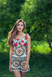 Portrait of beautiful girl wearing trendy outfit. Summer fashion Royalty Free Stock Image