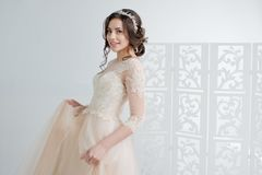 Portrait of a beautiful girl in a wedding dress. Bride in a luxurious dress, in a beautiful white interior. Portrait of a beautiful girl in a wedding dress stock photos
