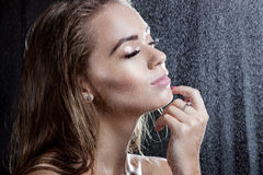 Portrait of a beautiful girl with wet hair.  under water drops Royalty Free Stock Image
