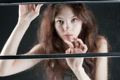 Portrait of beautiful girl in wet window Royalty Free Stock Image