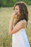 Portrait of a beautiful girl in a wheat field Stock Photos