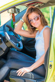 Portrait of a beautiful girl at the wheel Stock Photos