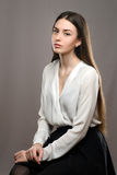 Portrait beautiful girl in white blouse and black skirt Royalty Free Stock Image