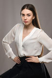 Portrait beautiful girl in white blouse and black skirt Royalty Free Stock Photography
