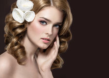 Portrait of a beautiful girl with white flowers on her hair. Beauty face. Royalty Free Stock Photo