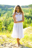 Portrait of a beautiful girl in white sundress Royalty Free Stock Photos