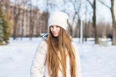 Portrait of a beautiful girl in white with very long hair in a snowy winter Royalty Free Stock Photo