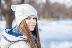 Portrait of a beautiful girl in white with very long hair in a snowy winter Stock Images