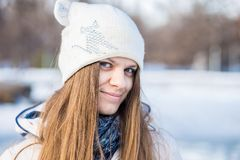 Portrait of a beautiful girl in white with very long hair in a snowy winter Royalty Free Stock Images
