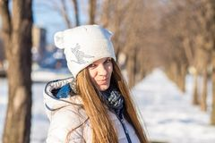 Portrait of a beautiful girl in white with very long hair in a snowy winter Royalty Free Stock Photography