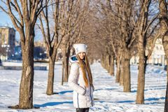 Portrait of a beautiful girl in white with very long hair in a snowy winter Royalty Free Stock Image