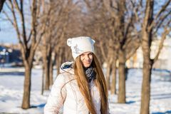 Portrait of a beautiful girl in white with very long hair in a snowy winter Stock Image