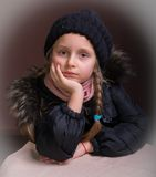 Portrait of beautiful girl in winter cloth. On a brown background Stock Photo