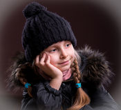 Portrait of beautiful girl in winter cloth. On a brown background Royalty Free Stock Photos