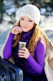 Portrait of beautiful girl in winter with coffee.  Royalty Free Stock Photo