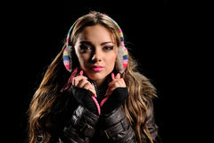 Portrait of beautiful girl in winter earmuff. Isolated over white background Stock Images