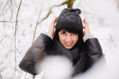 Portrait of a beautiful girl in winter forest Stock Photos