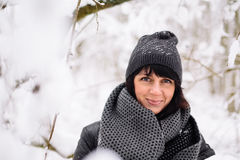 Portrait of a beautiful girl in winter forest Royalty Free Stock Photography