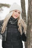Portrait of a beautiful girl in a winter forest. Soft focus Royalty Free Stock Photography