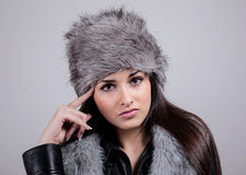 Portrait of beautiful girl with the winter hat on Stock Photos