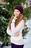 Portrait of beautiful girl in winter near the Christmas tree on the street.  Royalty Free Stock Photography