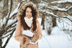 Portrait of a beautiful girl in winter. Outdoors Royalty Free Stock Images