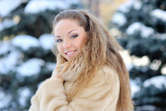 Portrait of beautiful girl in winter park.  Royalty Free Stock Photos