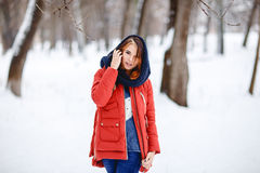 Portrait of a beautiful girl in a winter park. Outdoor Royalty Free Stock Photos
