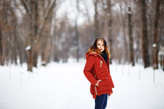 Portrait of a beautiful girl in a winter park. Royalty Free Stock Images