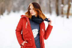 Portrait of a beautiful girl in a winter park. Stock Photos