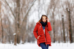 Portrait of a beautiful girl in a winter park. Royalty Free Stock Photo
