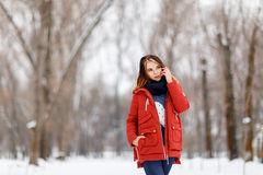 Portrait of a beautiful girl in a winter park. Royalty Free Stock Photos