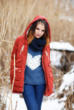 Portrait of a beautiful girl in a winter park. Royalty Free Stock Photography