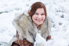 Portrait of beautiful girl with winter and snow background, outd Royalty Free Stock Photo