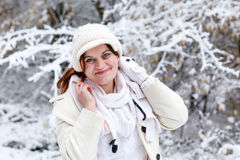 Portrait of beautiful girl with winter and snow background, outd. Oors Stock Photography