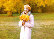 Portrait beautiful girl with yellow maple leafs outdoors Royalty Free Stock Photography
